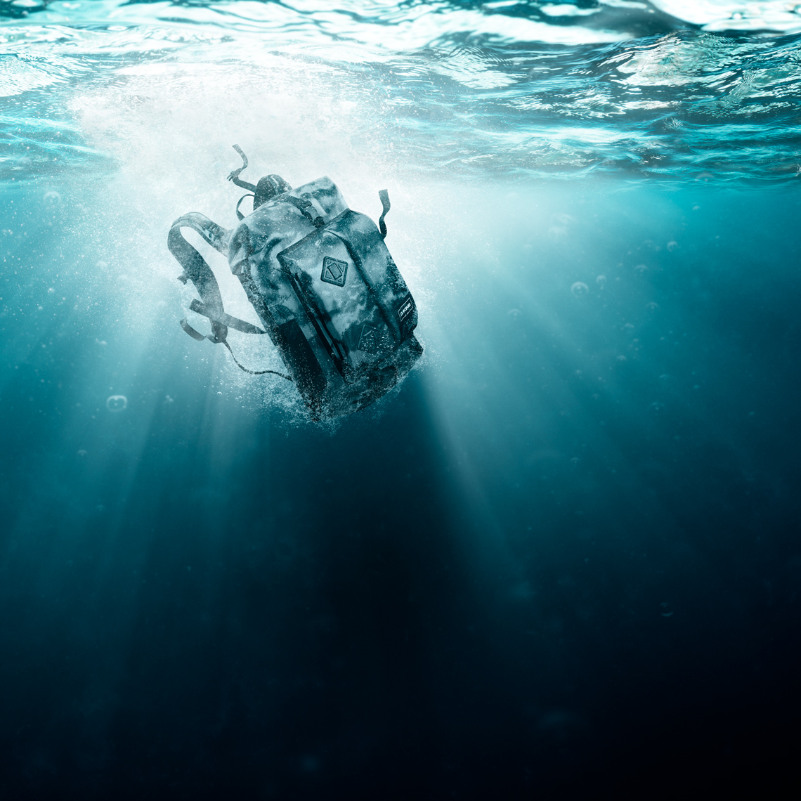 Dakine Drypack backpack splashing underwater image composite