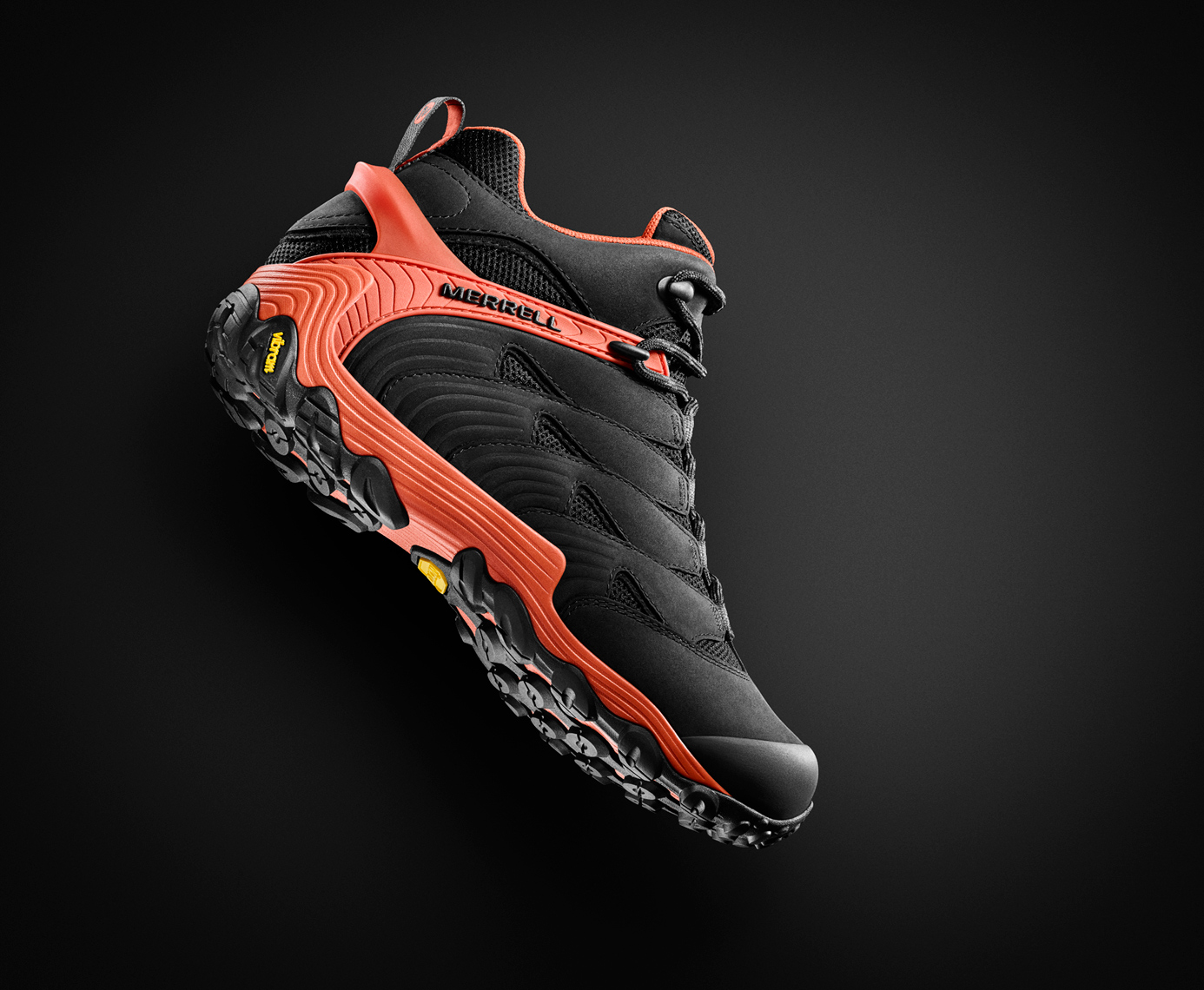Merrell Chameleon boot floating on black background